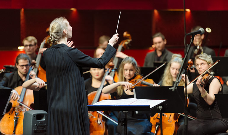 Conducting student Hanna Ohlson Nordh conducts the KMH Symphony Orchestra at the opening concert in the Royal Hall 2017.